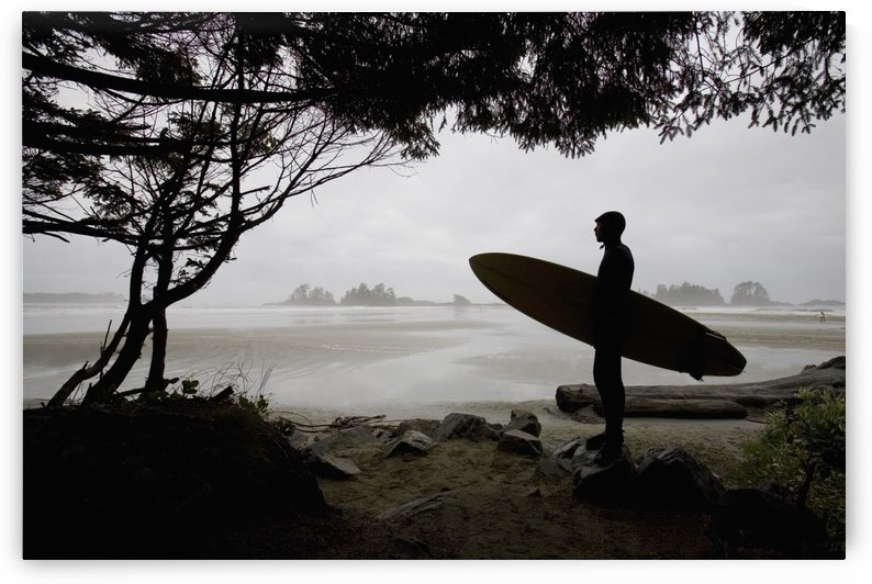 Silhouette Of A Surfer Looking Out To The Water From The Beach by PacificStock