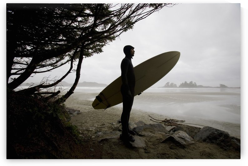 Surfer Observing Water From The Beach by PacificStock