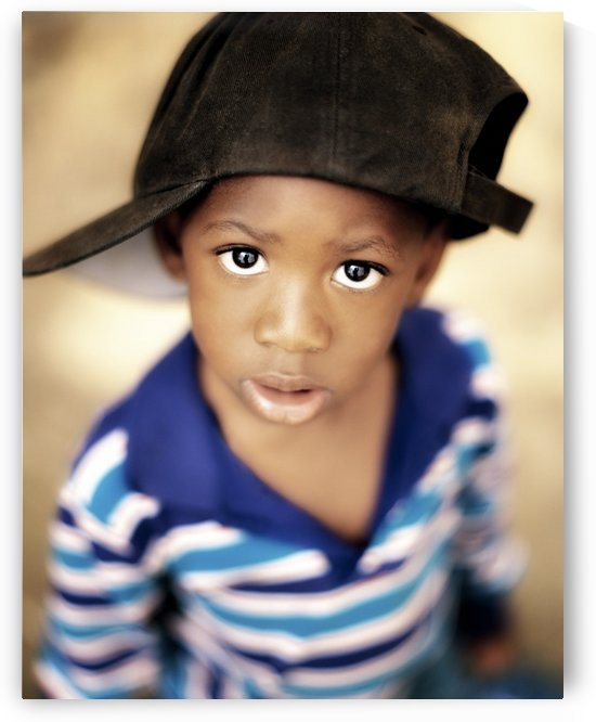 Boy Wearing Over Sized Hat Sideways by PacificStock