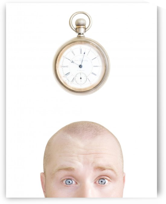 Part Of A Man's Head And A Stop Watch by PacificStock