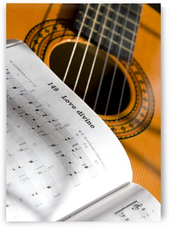 Guitar And Book Of Music by PacificStock