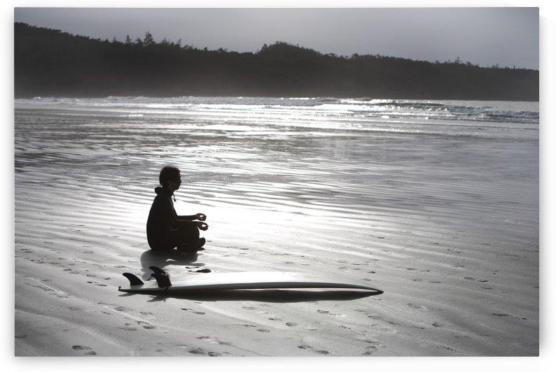 Surfer Meditating On Beach, Cox Bay Near Tofino, British Columbia, Canada by PacificStock