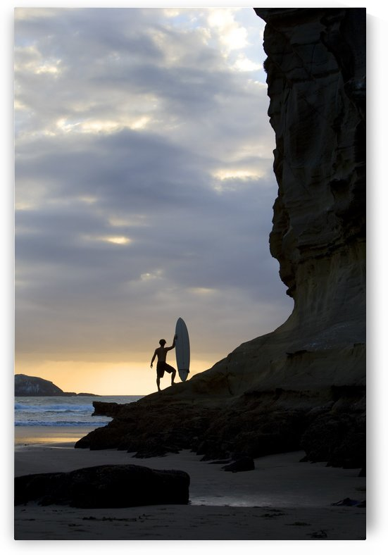 A Surfer On Muriwai Beach, New Zealand by PacificStock