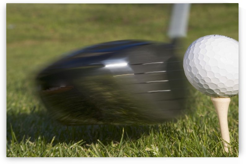 Golf Ball On Tee Hit By Driver by PacificStock