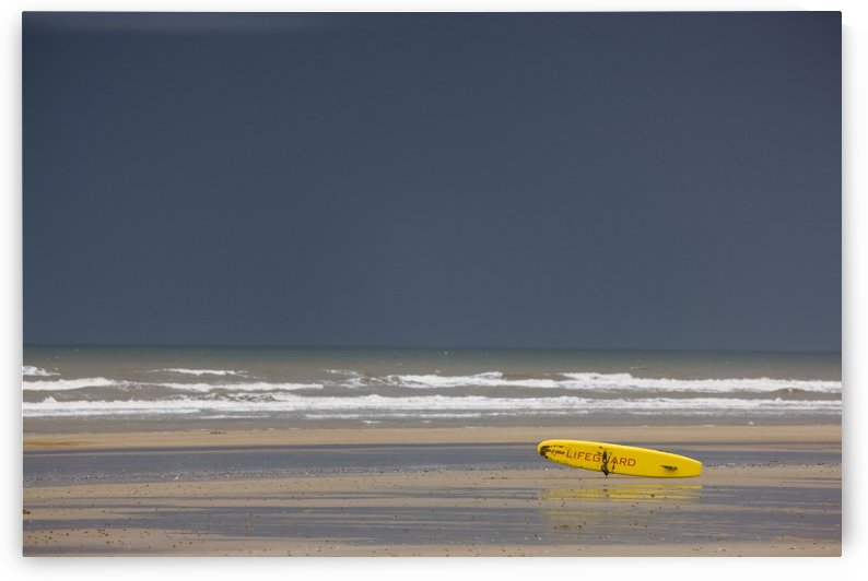 East Riding, Yorkshire, England; Surf Rescue Board Lying On The Foreshore by PacificStock