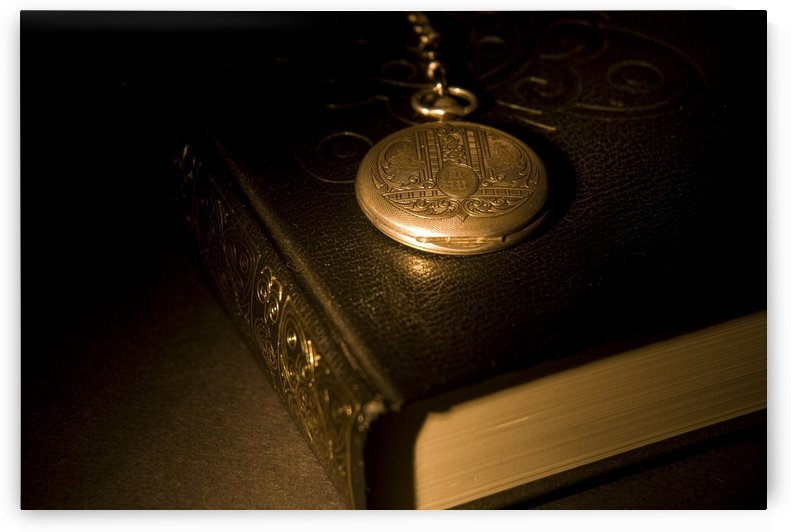 Gold Pocket Watch Resting On A Book by PacificStock