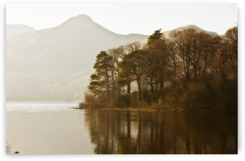 Calm Water With Mountains And Trees Along The Shoreline, England by PacificStock