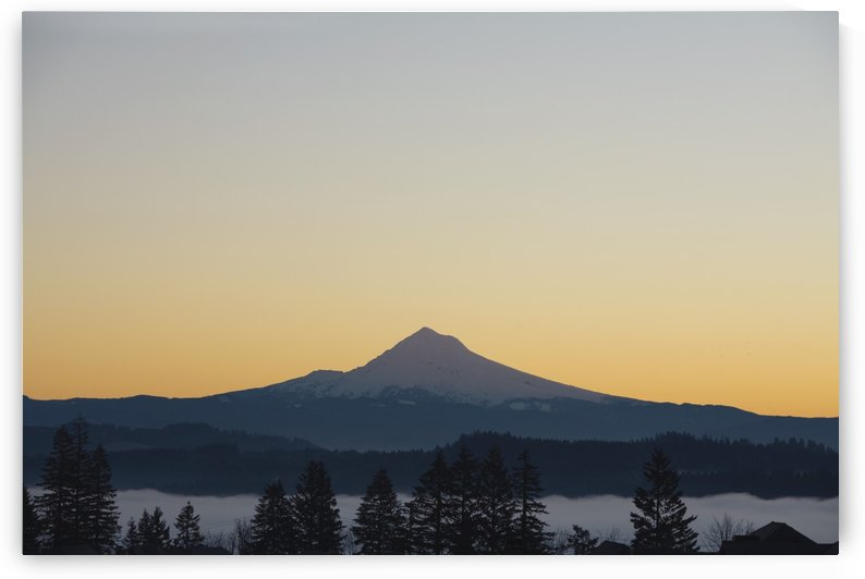 Silhouette Of Mountain Peak At Sunrise by PacificStock