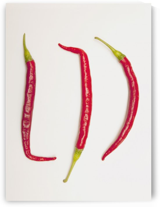 Three Red Jalapeno Peppers by PacificStock