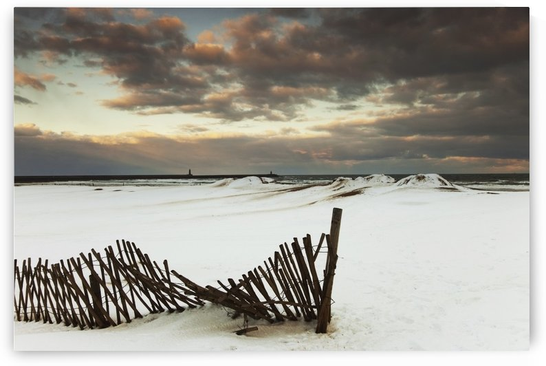 South Shields, Tyne And Wear, England; A Broken Fence In A Snow-Covered Field by PacificStock