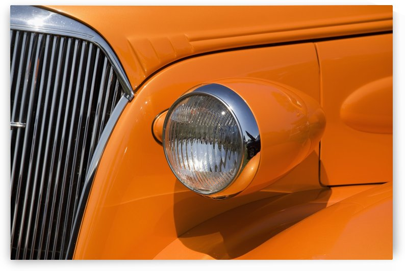 Orange Painted Vintage Car's Headlight And Front Grill; Port Colborne, Ontario, Canada by PacificStock