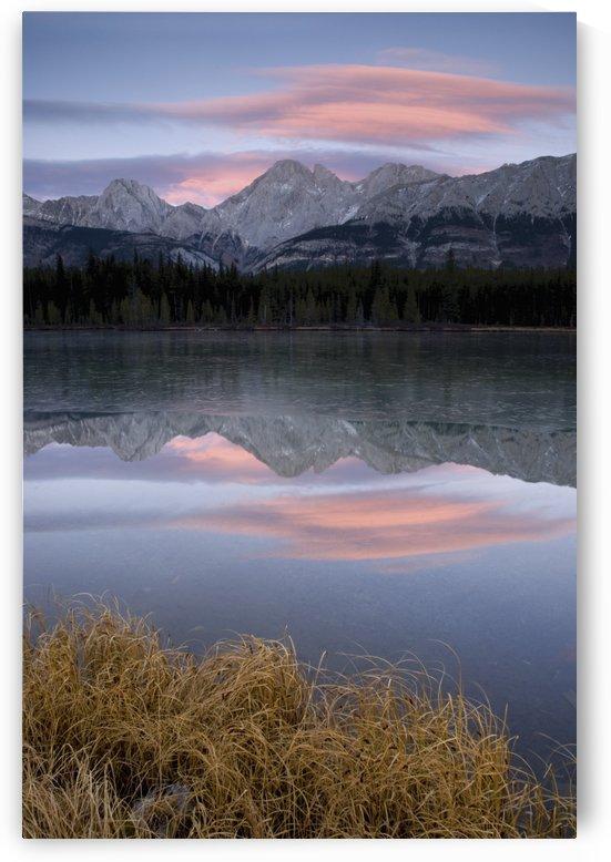 Partially Frozen Spillway Lake At Sunset; Kananaskis, Alberta, Canada by PacificStock