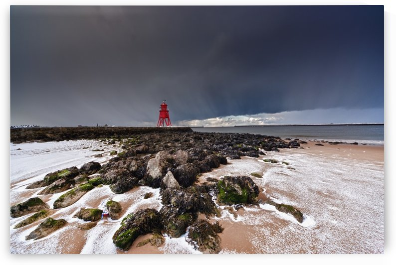 A Red Lighthouse Along The Coast Under A Stormy Sky; South Shields, Tyne And Wear, England by PacificStock