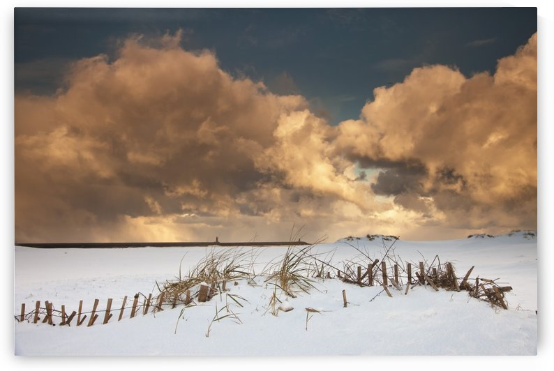 Illuminated Clouds Glowing Above A Snowy Field; South Shields, Tyne And Wear, England by PacificStock