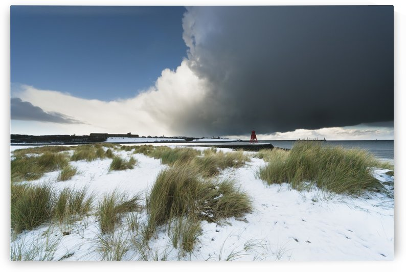 Dark Clouds And Blue Sky Over A Red Lighthouse Along The Coast In The Winter; South Shields, Tyne And Wear, England by PacificStock