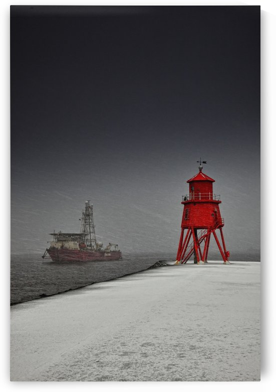 A Red Lighthouse Along The Coast In Winter With A Boat Off The Shore In The Water; South Shields, Tyne And Wear, England by PacificStock