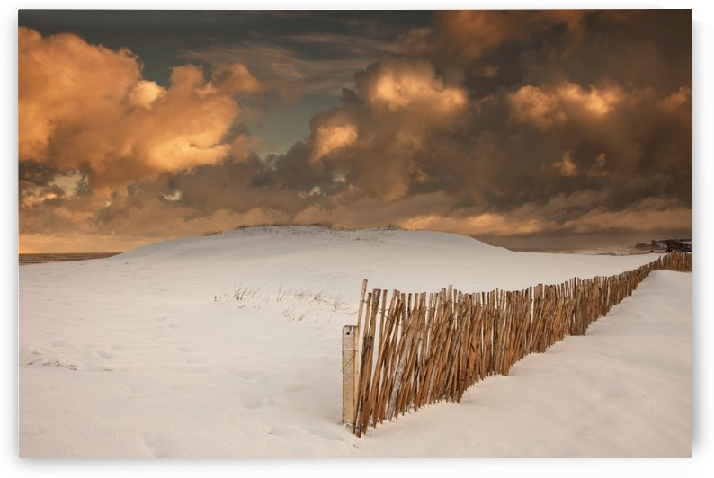 Illuminated Clouds Glowing Over A Snow Covered Field And Fence; South Shields, Tyne And Wear, England by PacificStock