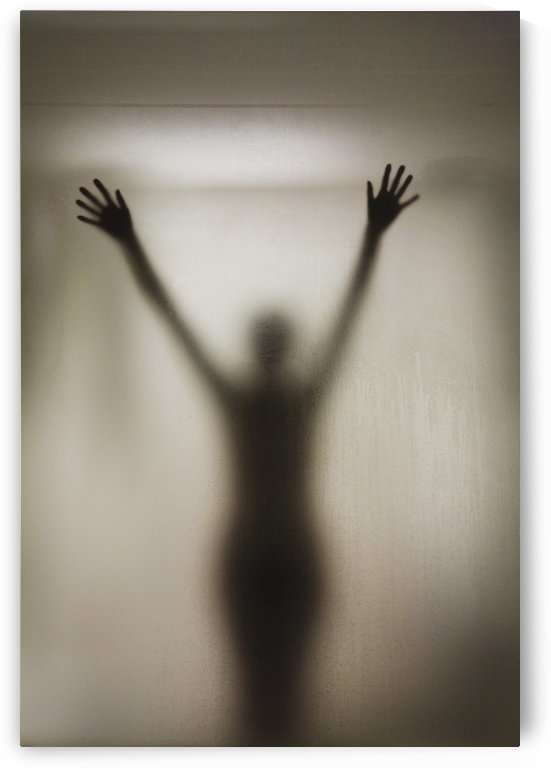 Silhouette Of A Nude Woman Behind The Glass Door Of A Shower Stall by PacificStock