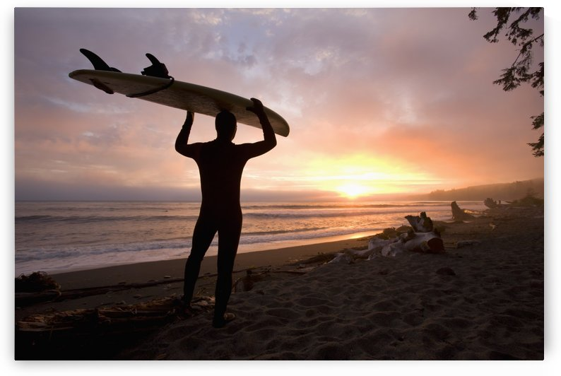 A Man Carrying His Surfboard; Sombrio Beach, Vancouver Island, British Columbia, Canada by PacificStock