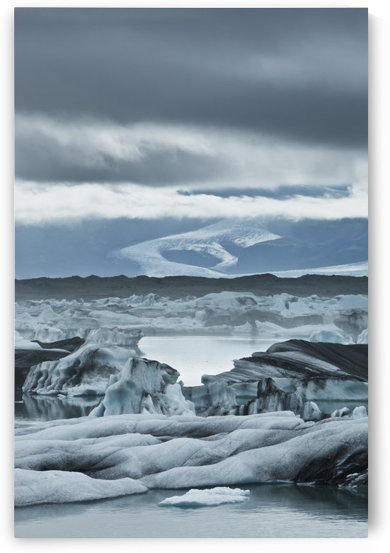 Ice Formations On The Rock In The Water; Jokulsarlon, Iceland by PacificStock