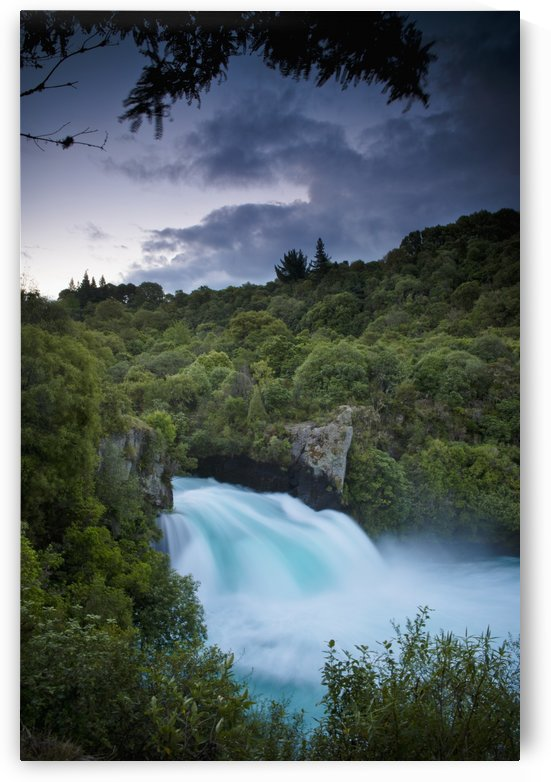 A Waterfall Surrounded By A Forested Area; New Zealand by PacificStock