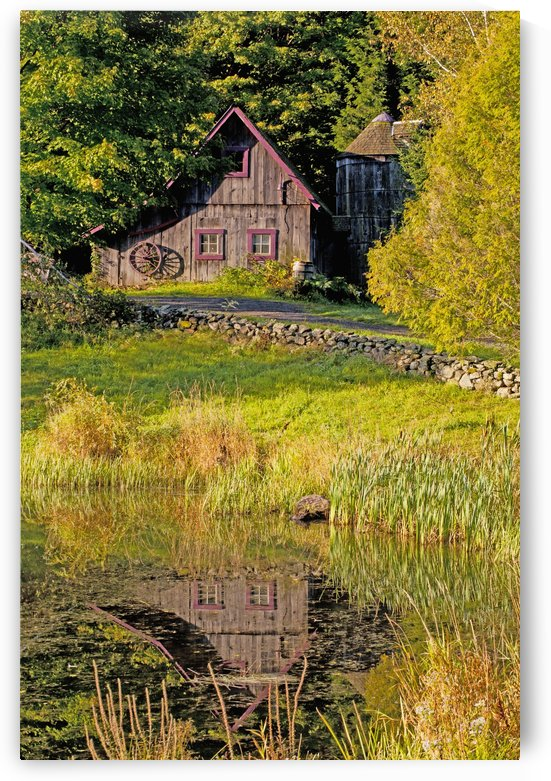 An Old Barn Reflected In The Pond Water; Ville De Lac Brome, Quebec, Canada by PacificStock