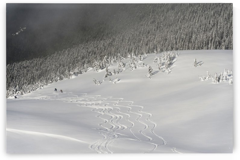 Skiers At The Base Of A Mountain; Whistler, British Columbia, Canada by PacificStock