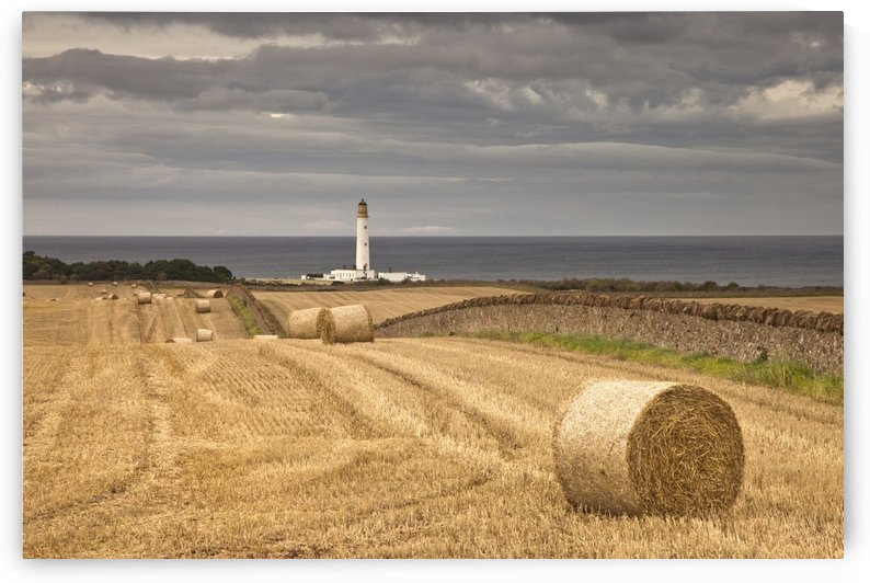 Barns Ness Lighthouse Along The Coast And Hay Bales In A Field In The Foreground; Lothian, Scotland by PacificStock