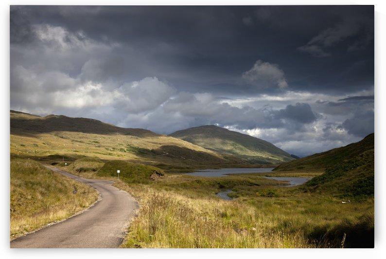 A Road Curving Through A Mountainous Landscape; Ardnamurchan, Argyl,Scotland by PacificStock
