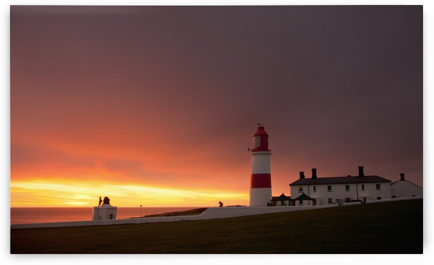 A Lighthouse On The Coast At Sunset; Whitburn, Tyne And Wear, England by PacificStock