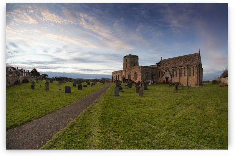 Path Leading To A Church Building And Cemetery; Bamburgh, Northumberland, England by PacificStock