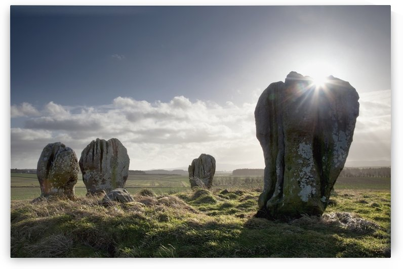 Sunlight Shining On The Standing Stones Of Duddo; Northumberland, England by PacificStock