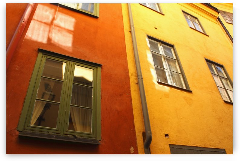 Low Angle View Of Red And Yellow Painted Buildings; Stockholm, Sweden by PacificStock