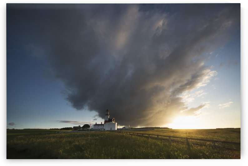 Souter lighthouse with a cloud formation above it at sunrise;South shields tyne and wear england by PacificStock