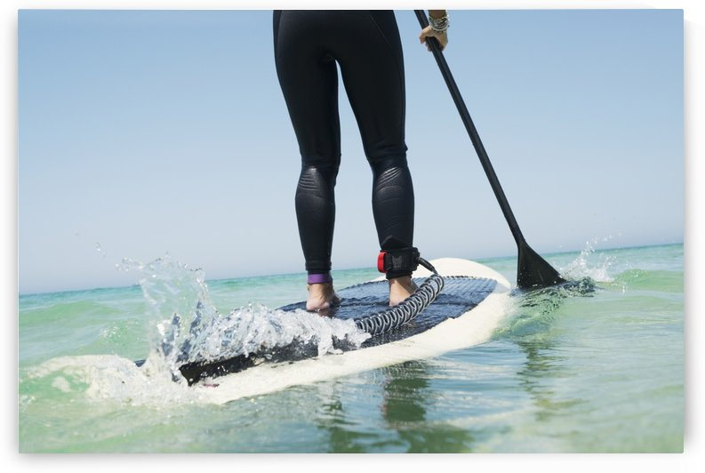 Paddling on a surfboard;Tarifa cadiz andalusia spain by PacificStock