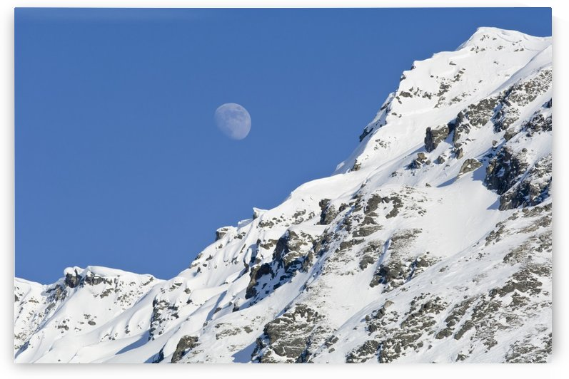Moon Rising Over Snow Covered Mountain Peak At Hatcher Pass In Southcentral Alaska by PacificStock