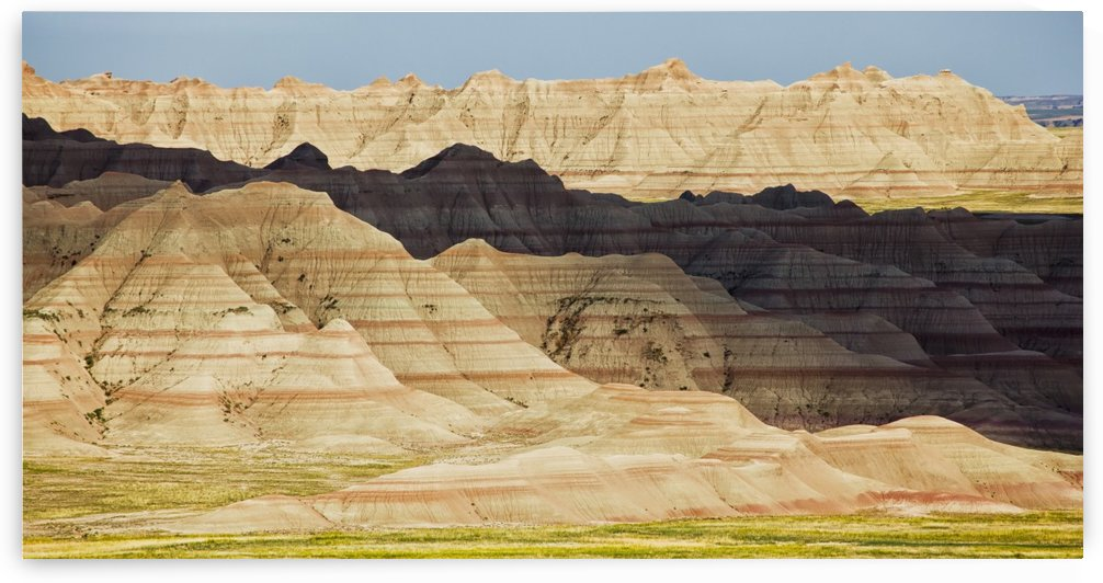 Light and shadows paint the landscape of badlands national park; south dakota united states of america by PacificStock