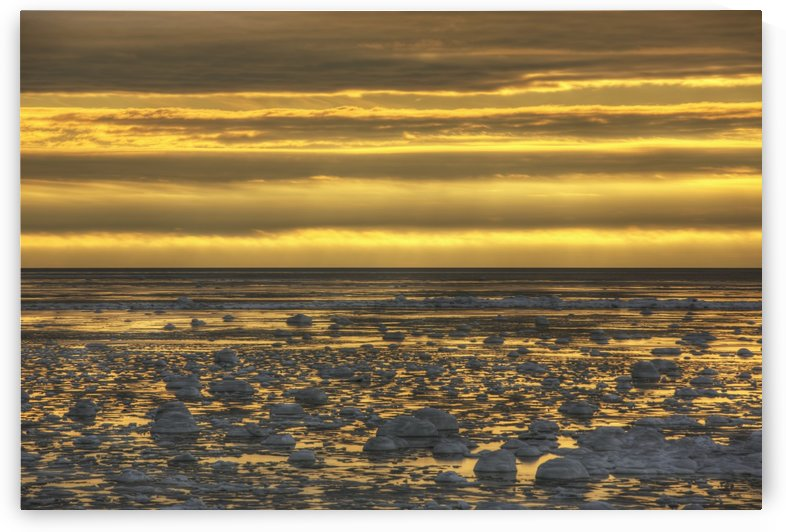 Sunrise over an ice filled bay of hudson's bay;Manitoba canada by PacificStock