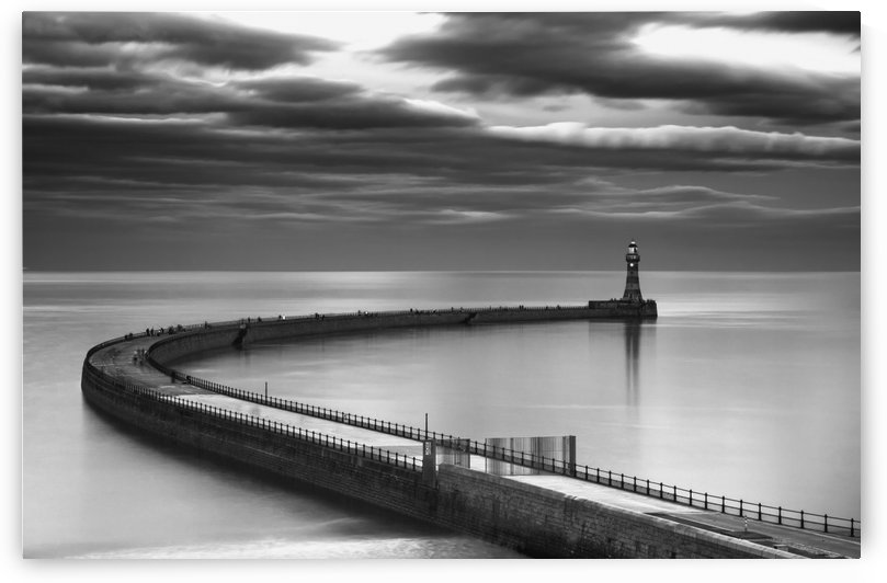 A curving pier with a lighthouse at the end;Sunderland tyne and wear england by PacificStock