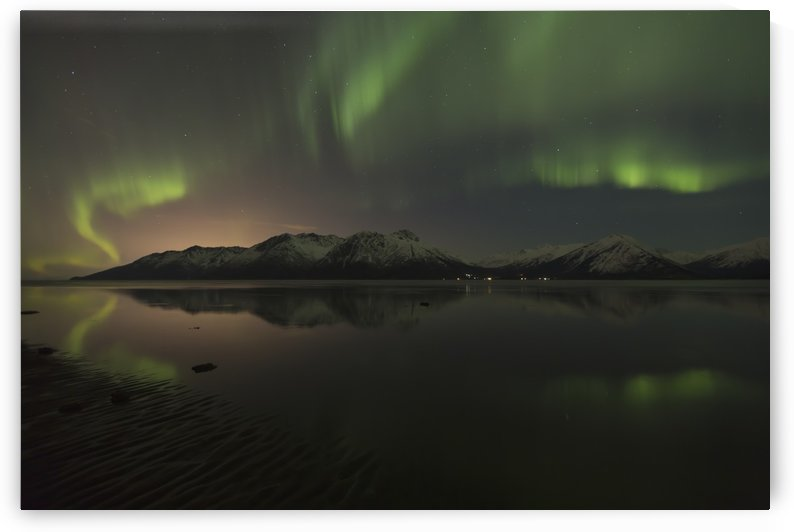View of the Aurora Borealis (Northern Lights) dancing above the Chugach Mountains and reflecting in the waters of Turnagain Arm, Kenai Peninsula, Southcentral, Alaska, Winter by PacificStock