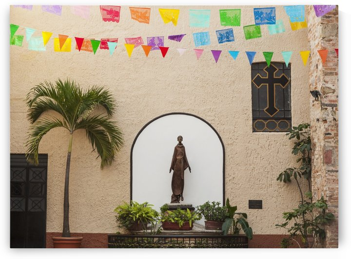 A sculpture of san francisco de assisi is sheltered by the church of our lady of guadalupe;Puerto vallarta mexico by PacificStock