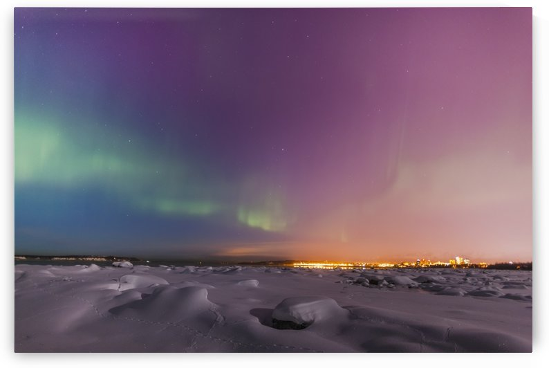 Northern lights shine above city skyline in this nighttime view from the tony knowles coastal trail in winter;Anchorage alaska united states of america by PacificStock