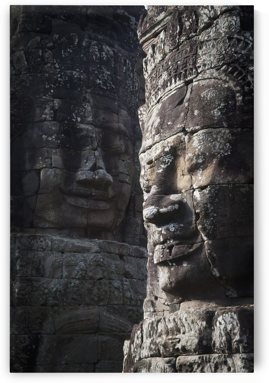 Face sculptures on stone walls at angkor wat;Cambodia by PacificStock