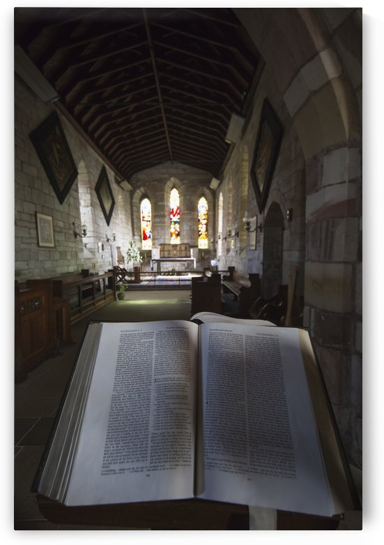View of the interior of a church with stained glass windows and an open Bible; Bamburgh, Northumberland, England by PacificStock