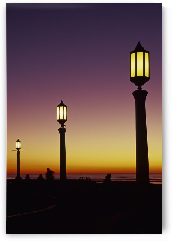 The streetlights come on at dusk; Seaside, Oregon, United States of America by PacificStock