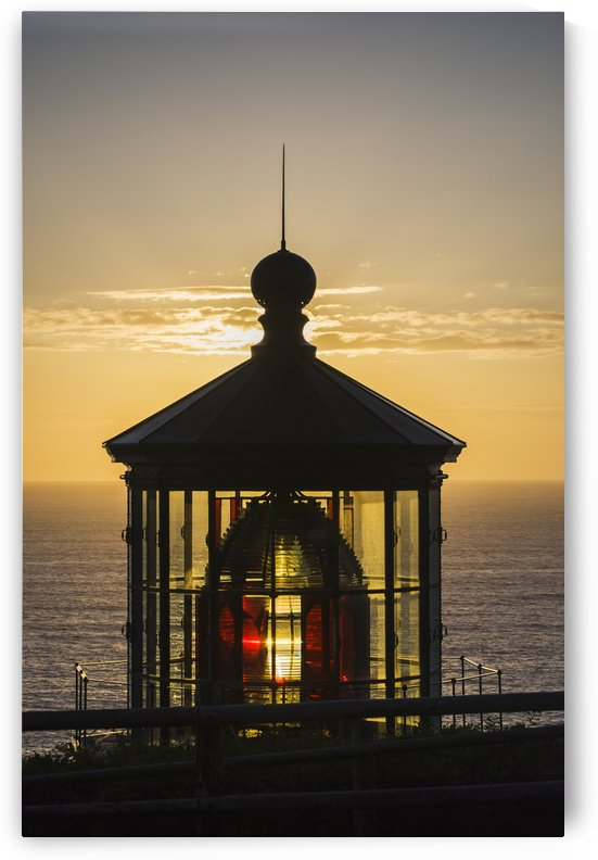 The sun sets at Cape Meares Lighthouse; Oregon, United States of America by PacificStock