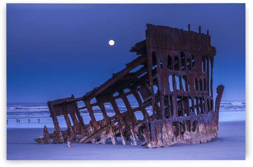 The moon sets over the wreck of the Peter Iredale; Oregon, United States of America by PacificStock