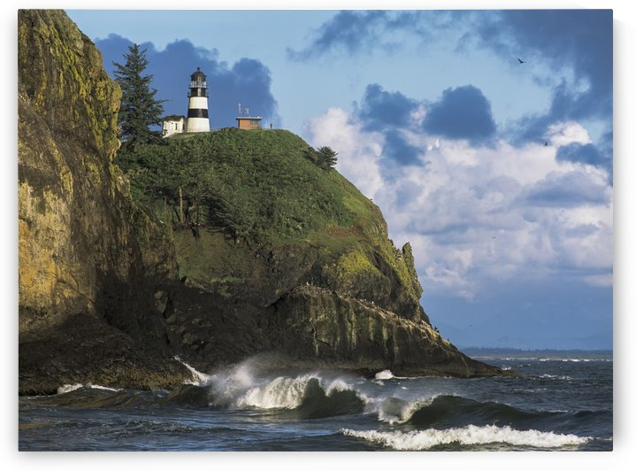 Waves break at Cape Disappointment Lighthouse; Ilwaco, Washington, United States of America by PacificStock
