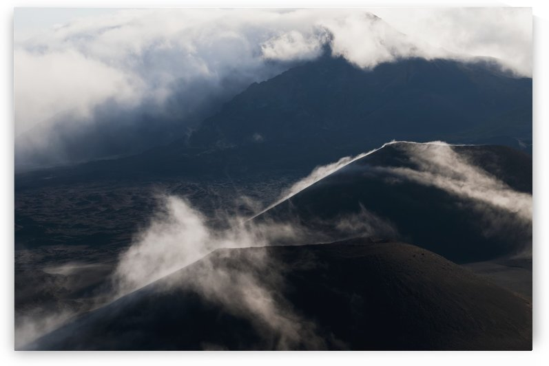 Morning clouds begin to burn off of Haleakala National Park; Maui, Hawaii, United States of America by PacificStock