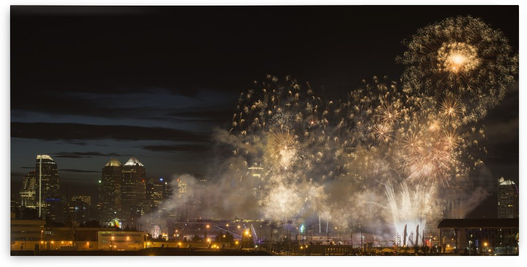 Fireworks in front of modern city skyline; Calgary, Alberta, Canada by PacificStock